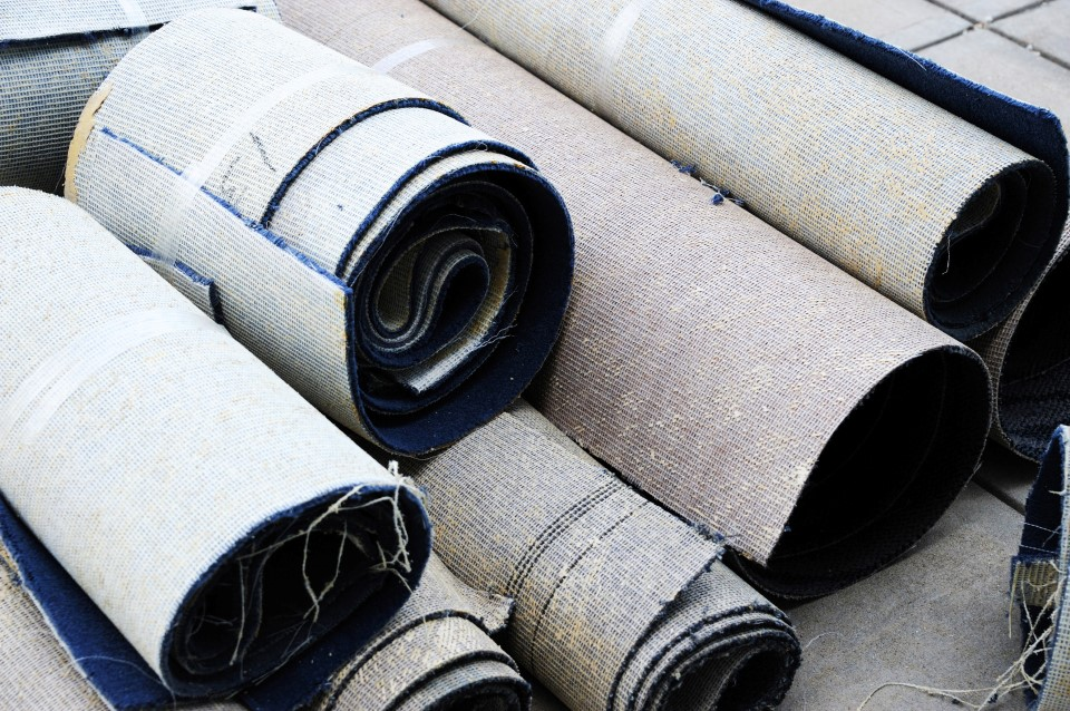 Close up on stacking carpet rolls for home improvement